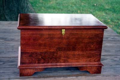 Blanket chest like container for horse cremains. A brass plate is included free of charge. Three lines of text may be engraved.