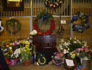 """Brigadier's stall, with a rosewood urn for his ashes, that was graciously donated by someone who was touched by this tragedy. Carrots, apples and other treats have been filling the hallway for a week."""